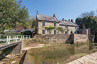 BNPS.co.uk (01202) 558833. <br /> Pic: TimHardy/KnightFrank/BNPS<br /> <br /> A traditional country cottage in a hidden valley surrounded by its own woodland is on the market for offers over £700,000.<br /> <br /> Beck Cottage sits in a stunning position with a stream that has fishing rights and an idyllic private natural pool with a waterfall.<br /> <br /> Estate agent Knight Frank say it is a rare opportunity for someone to get their own bit of unspoilt England as the cottage is on the market for the first time in about 70 years.<br /> <br /> The five-bedroom property is close to the seaside town of Whitby and the North York Moors National Park.