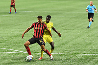 ATLANTA, GA - AUGUST 22: Miles Robinson #12 and Dominique Badji #9 wrestle for the ball during a game between Nashville SC and Atlanta United FC at Mercedes-Benz Stadium on August 22, 2020 in Atlanta, Georgia.