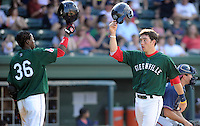 Catcher Blake Swihart (10) of the Greenville Drive, right, high-fives with teammate Jose Vinicio (36) after scoring a run in a game against the Rome Braves on May 6, 2012, at Fluor Field at the West End in Greenville, South Carolina. Swihart was a first-round pick (26th overall) by the Boston Red Sox in the 2011 First-Year Player Draft. Greenville won, 11-3. (Tom Priddy/Four Seam Images)