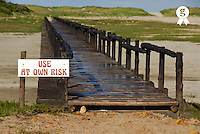 Wooden Bridge over dry pond with warning sign - South Africa, South Western Cape, Hermanus (Licence this image exclusively with Getty: http://www.gettyimages.com/detail/sb10069714af-001 )
