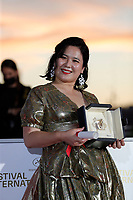 CANNES, FRANCE - JULY 17: Tang Yi poses with the Best Short Movie Award for 'Tous les corbeaux du monde' during the 74th annual Cannes Film Festival on July 17, 2021 in Cannes, France.<br /> CAP/GOL<br /> ©GOL/Capital Pictures