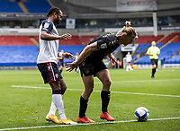 Bolton Wanderers' Nathan Delfouneso competing with Oldham Athletic's Carl Piergianni (right) <br /> <br /> Photographer Andrew Kearns/CameraSport<br /> <br /> The EFL Sky Bet League Two - Bolton Wanderers v Oldham Athletic - Saturday 17th October 2020 - University of Bolton Stadium - Bolton<br /> <br /> World Copyright © 2020 CameraSport. All rights reserved. 43 Linden Ave. Countesthorpe. Leicester. England. LE8 5PG - Tel: +44 (0) 116 277 4147 - admin@camerasport.com - www.camerasport.com