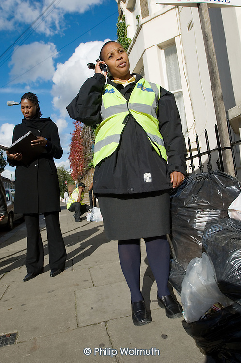 Westminster City Guardian Rosaline Herman and City Guardian Manager Doreen Horsley with dumped rubbish in the Harrow Road area, North Paddington.