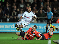 Pictured: Wayne Routledge of Swansea (TOP) is brought down by Clint Hill of QPR. Tuesday 27 December 2011<br />