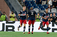 FOXBOROUGH, MA - JULY 7: Adam Buksa #9 of New England Revolution celebrates his goal with teammate during a game between Toronto FC and New England Revolution at Gillette Stadium on July 7, 2021 in Foxborough, Massachusetts.