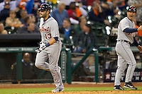 Detroit Tigers catcher Alex Avila (13) jogs rounds third base after hitting a go-ahead two run home run in the ninth inning of the MLB baseball game against the Houston Astros on May 3, 2013 at Minute Maid Park in Houston, Texas. Detroit defeated Houston 4-3. (Andrew Woolley/Four Seam Images).