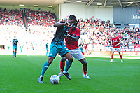 Kyle Naughton of Swansea City battles with Famara Diédhiou of Bristol City during the Sky Bet Championship match between Bristol City and Swansea City at Ashton Gate in Bristol, England, UK. Saturday 21 September 2019