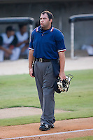 Home plate umpire Jay Pierce between innings of the South Atlantic League game between the Augusta GreenJackets and the Kannapolis Intimidators at Fieldcrest Cannon Stadium in Kannapolis, NC, Wednesday August 20, 2008. (Photo by Brian Westerholt / Four Seam Images)