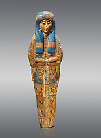 Ancient Egyptian sarcophagus inner coffin of  singer Tabakenkhonsu, Temple of Hatshepsut at Deir el-Bahri. Thebes, 2nd half of 21st Dynasty, 680–670 B.C. Egyptian Museum, Turin. Grey background.<br /> <br /> The deceased is depicted with her hands rendered in high relief on top of a wesekh collar. a stylistic trait that allows the coffin to be dated from the late 21st Dynsaty. the inner coffin is of great quality depicting mythological scenes derived from the Book of the Dead spells.