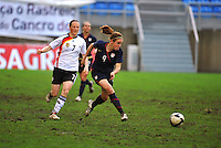 Heather O'Reilly strikes the ball. The USA captured the 2010 Algarve Cup title by defeating Germany 3-2, at Estadio Algarve on March 3, 2010.