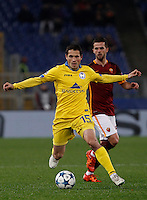 Calcio, Champions League: Gruppo E - Roma vs Bate Borisov. Roma, stadio Olimpico, 9 dicembre 2015.<br /> Bate Borisov's Maksim Zhavnerchik, left, is chased by Roma's Miralem Pjanic during the Champions League Group E football match between Roma and Bate Borisov at Rome's Olympic stadium, 9 December 2015.<br /> UPDATE IMAGES PRESS/Isabella Bonotto