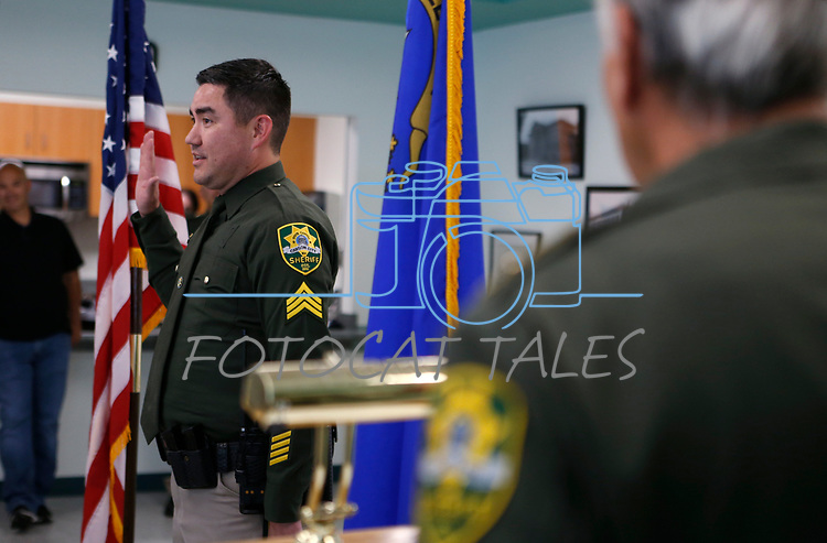 Sgt. Steve Olson gets sworn in at a promotion ceremony at Carson City Sheriff's Office, in Carson City, Nev., on Thursday, July 2, 2020. <br /> Photo by Cathleen Allison
