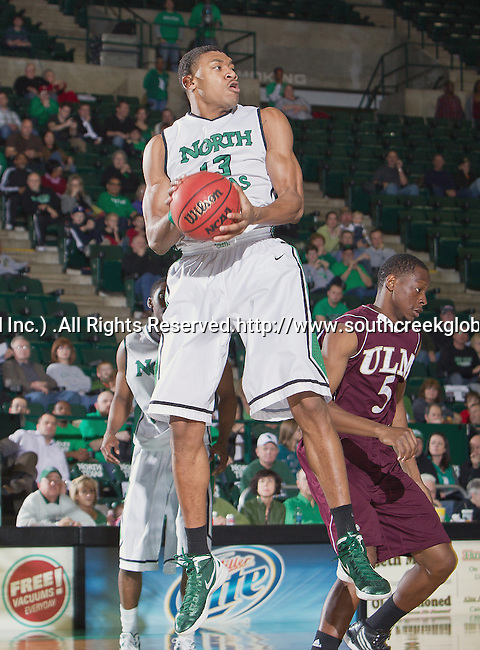 North Texas Mean Green forward Tony Mitchell (13) in action during the game between the Louisiana Monroe Warhawks and the University of North Texas Mean Green at the North Texas Coliseum,the Super Pit, in Denton, Texas. UNT defeats ULM 86 to 51...