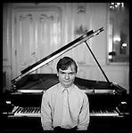 A musician at the palaffy palace before a piano recital, Prague, Czech Republic.