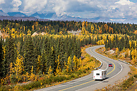 Motorhome travels the George Parks highway as it winds through the autumn boreal forest, Interior, Alaska.