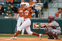 Texas Longhorns designated hitter Ben Johnson #14 follows through on his swing against the Oklahoma Sooners in the NCAA baseball game on April 5, 2013 at UFCU DischFalk Field in Austin Texas. Oklahoma defeated Texas 2-1. (Andrew Woolley/Four Seam Images).