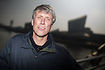 © Joel Goodman - 07973 332324 . NO SYNDICATION PERMITTED . 19/03/2015 . Salford Quays , UK . MARK BERRY ( Bez ) at Salford Quays . Black Grape photocall at The Green , Salford Quays , Greater Manchester . Black Grape are reforming for a Madchester charity gig along with other local bands , to raise awareness for Bez's Reality Party and anti-fracking . Photo credit : Joel Goodman