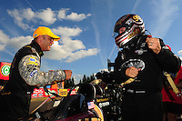 Aug. 7, 2011; Kent, WA, USA; NHRA top fuel dragster driver Del Worsham (right) is congratulated by Tony Schumacher  after winning the Northwest Nationals at Pacific Raceways. Mandatory Credit: Mark J. Rebilas-