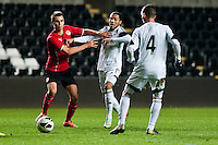 Monday 20 January 2014<br /> Pictured: Kenji Gorre ( centre ) fails to push his way through the Cardiff defence<br /> Re: Swansea City U21 v Cardiff City U21 at the Liberty Stadium, Swansea Wales