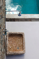 stone basin next to the swimming pool