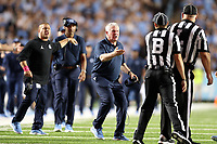 CHAPEL HILL, NC - SEPTEMBER 07: Head Coach Mack Brown of the University of North Carolina complains to Line Judge Kirk Lewis and Back Judge Michael Griffith during a game between University of Miami and University of North Carolina at Kenan Memorial Stadium on September 07, 2019 in Chapel Hill, North Carolina.