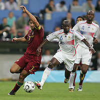 French midfielder (6) Claude Makelele fights for the ball with Portuguese forward (7) Luis Figo.  France defeated Portugal, 1-0, in their FIFA World Cup semifinal match at FIFA World Cup Stadium in Munich, Germany, July 5, 2006.