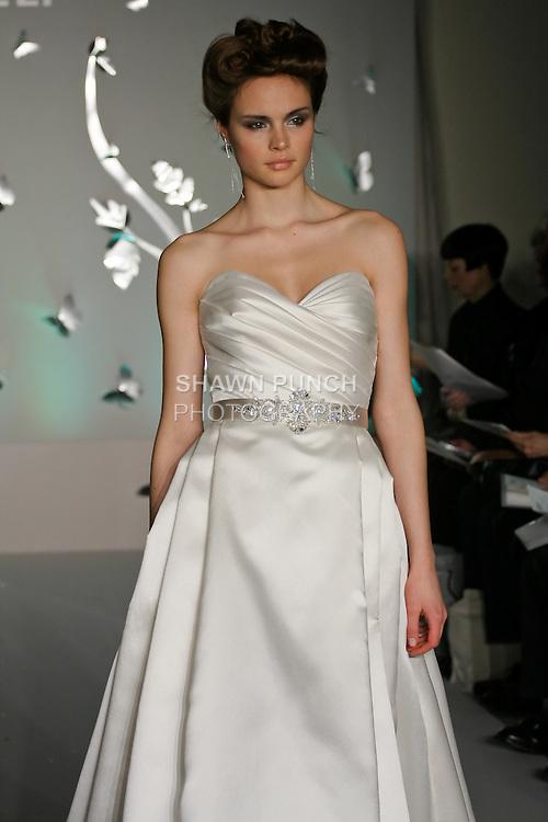 Model walks runway in a Tara Kelly Fall 2011 bridal dress by Lazaro Perez, for the JLM Couture Fall 2011 Bridal fashion show.