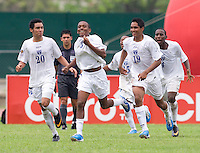 Eder Velasquez (6) of Honduras celebrates his goal with teammates during the group stage of the CONCACAF Men's Under 17 Championship at Catherine Hall Stadium in Montego Bay, Jamaica. Honduras defeated Barbados, 2-1.