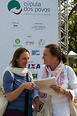 Tamsin Ramsay and Valeriane Bernard from the Brahma Kumarist World Spiritual University planning where to go at the People's Summit, United Nations Conference on Sustainable Development (Rio+20), Rio de Janeiro, Brazil, 15th June 2012. Photo © Sue Cunningham.