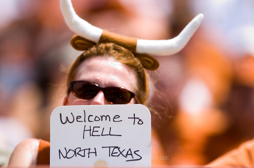 02 September 2006: University of Texas alum and football fanatic Peggy Little cools off with a handheld fan she customized during the Longhorns 56-7 victory over the Eagles at Darrell K Royal Stadium in Austin, TX.