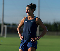KASHIMA, JAPAN - AUGUST 4: Carli Lloyd #10 of the USWNT warms up during a training session at the practice field on August 4, 2021 in Kashima, Japan.
