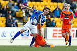 St Johnstone v Dundee United...11.02.12.. SPL.Chris Millar gets a kick from Scott Robertson.Picture by Graeme Hart..Copyright Perthshire Picture Agency.Tel: 01738 623350  Mobile: 07990 594431