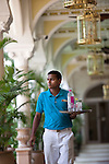 MUMBAI, INDIA - SEPTEMBER 27, 2010:  One of the pool staff brings drinks for  guests at the Taj Mahal Palace and Tower Hotel in Mumbai. The Hotel has re-opened after the terror attacks of 2008 destroyed much of the heritage wing. The wing has been renovated and the hotel is once again the shining jewel of Mumbai. pic Graham Crouch