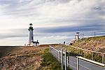Yaquina Head Lighthouse, Oregon Coast near Newport, Oregon.  Oregon Central Coast, beaches, bays, bars, family fun, winter storms, lighthouses, fishing boats, bluffs, fossils and beach walks.