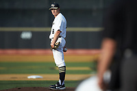 Wake Forest Demon Deacons starting pitcher Colin Peluse (8) looks to his catcher for the sign against the North Carolina State Wolfpack at David F. Couch Ballpark on April 18, 2019 in  Winston-Salem, North Carolina. The Demon Deacons defeated the Wolfpack 7-3. (Brian Westerholt/Four Seam Images)