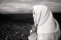 Woman with scarf wrapped around head<br />