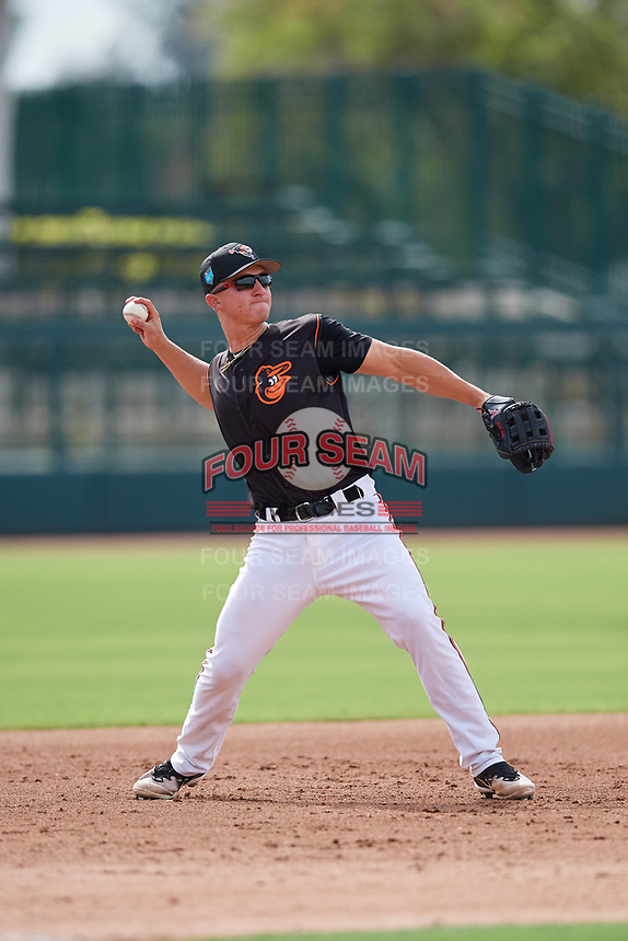 GCL Orioles third baseman Jared Gates (18) throws to first base during the first game of a doubleheader against the GCL Twins on August 1, 2018 at CenturyLink Sports Complex Fields in Fort Myers, Florida.  GCL Twins defeated GCL Orioles 7-6 in the completion of a suspended game originally started on July 31st, 2018.  (Mike Janes/Four Seam Images)