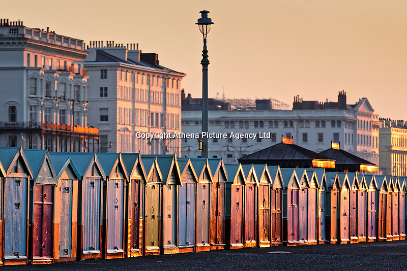 The coloured beach huts at the Brighton seafront a freezing cold but clear morning  in East Sussex, England UK. Saturday 24 February 2018