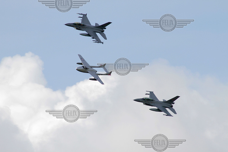 Two Norwegian F-16 in Formation with a DH Vampire during Tiger Air show.  Nato Tiger Meet is an annual gathering of squadrons using the tiger as their mascot. While originally mostly a social event it is now a full military exercise. Tiger Meet 2012 was held at the Norwegian air base Ørlandet.
