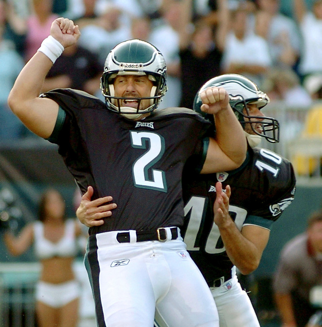 Philadelphia Eagles kicker David Akers (2) reacts with his teammate Koy Detmer (10) after kicking the winning field goal in the final seconds of the fourth quarter against the Oakland Raiders in Philadelphia, September 25, 2005. REUTERS/Bradley C Bower