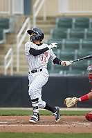 Laz Rivera (13) of the Kannapolis Intimidators follows through on his swing against the Lakewood BlueClaws at Kannapolis Intimidators Stadium on April 8, 2018 in Kannapolis, North Carolina.  The Intimidators defeated the BlueClaws 4-3 in game two of a double-header.  (Brian Westerholt/Four Seam Images)