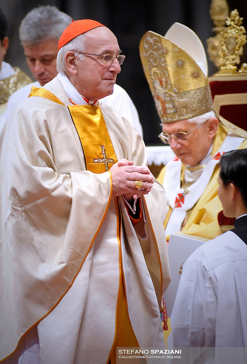 Pope Benedict XVI (L) gives his cardinal ring to German Walter Brandmueller (R) during the Eucharistic celebration with the new cardinals on November 21, 2010 at St Peter's basilica at The Vatican. 24 Roman Catholic prelates joined the day before the Vatican's College of Cardinals, the elite body that advises the pontiff and elects his successor upon his death.