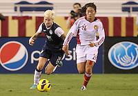 BOCA RATON, FL - DECEMBER 15, 2012: Megan Rapinoe (15) of the USA WNT chases after Wu Haiyan (26) of China WNT during an international friendly match at FAU Stadium, in Boca Raton, Florida, on Saturday, December 15, 2012. USA won 4-1.
