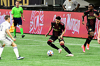 ATLANTA, GA - APRIL 24: Atlanta United midfielder #10 Marcelino Moreno dribbles the ball during a game between Chicago Fire FC and Atlanta United FC at Mercedes-Benz Stadium on April 24, 2021 in Atlanta, Georgia.
