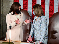 US Vice President Kamala Harris (L) speaks with Speaker of the US House of Representatives Nancy Pelosi (D-CA) ahead of US President Joe Biden addressing a joint session of Congress at the US Capitol in Washington, DC, on April 28, 2021. <br /> CAP/MPI/RS<br /> ©RS/MPI/Capital Pictures