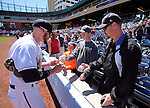 Reno Aces' Tyler Kuhn signs autographs before the game against the Sacramento River Cats in Reno, Nev., on Sunday, April 14, 2013. The River Cats won 22-6..Photo by Cathleen Allison
