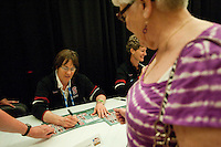 DENVER, CO--Tara VanDerveer signs posters during a fan autograph session at the Pepsi Center for the 2012 NCAA Women's Final Four festivities in Denver, CO.