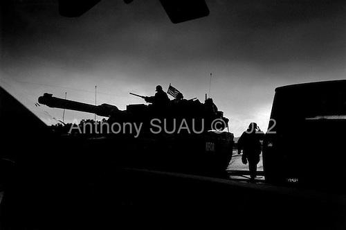 Kosovo  <br /> 1999<br /> <br /> American tanks and troops move up the road to Pristina from Macedonia only after Serbian troops killed, expelled, burnt, and looting hundreds of thousands of ethnic Kosovo, Albanians from Kosovo.