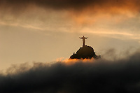 The Christ the Redeemer statue rises above the clouds in Rio de Janeiro, Feb. 29, 2004. The statue was built in 1921 atop the 710 meter Corcovado mountain.(AustralFoto/Douglas Engle)