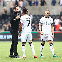 25th September 2021; Swansea.com Stadium, Swansea, Wales; EFL Championship football, Swansea versus Huddersfield; Russell Martin, Manager of Swansea City celebrates with Korey Smith of Swansea City after the 1-0 win